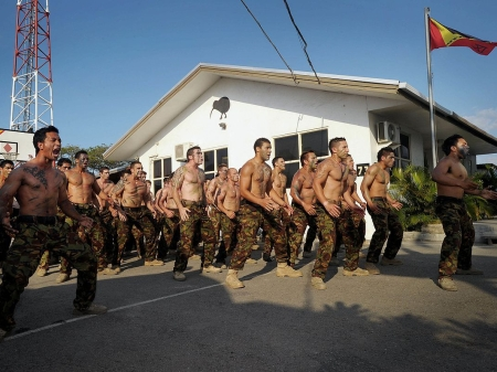 International Stabilisation Force members of Task Group GYRO 11 welcome the arriving New Zealand soldiers, sailors, airmen and airwomen of Task Group GYRO 12 to East Timor with a traditional Maori Powhiri (welcome ceremony) on Thursday, 03 November 2011.