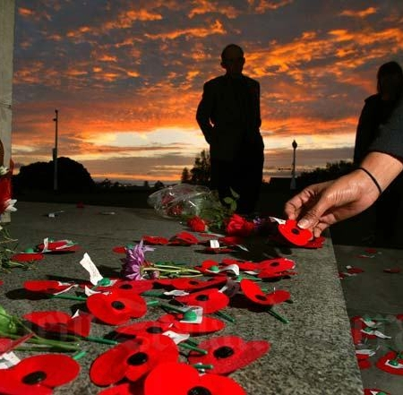 ANZAC poppies on a Cenotaph at dawn