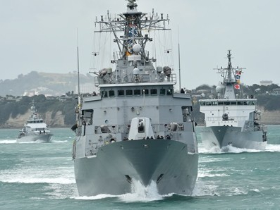A formation of Royal New Zealand Navy warships manoeuvring.