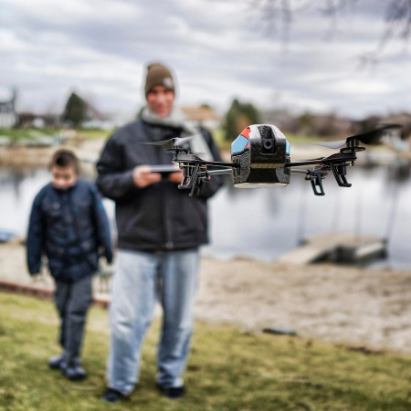 Man and Child Civilian Drone Operator